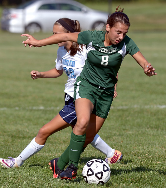 Pennridge's Erin Stevenson reverses the ball on North Penn's Kristin Wilkinson Monday Sept. 15, 2014.<br /> Montgomery Media staff photo by Bob Raines