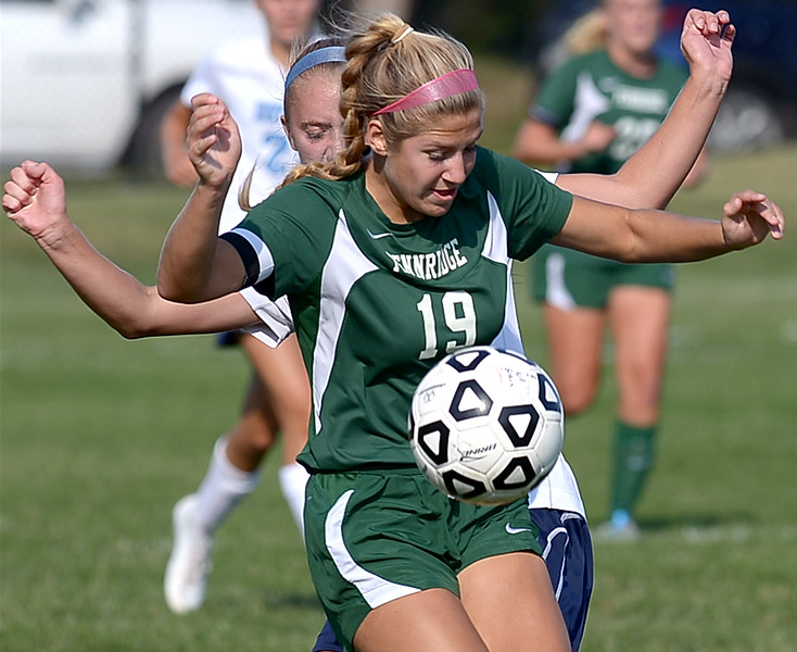 Pennridge's Jess Milligan traps the ball in front of North Penn's Liz Volz Monday, Sept. 15, 2014.<br /> Montgomery Media staff photo by Bob Raines