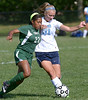 Pennridge's Kennedy Peace battles for the ball with North Penn's Liz Volz Monday Sept. 15, 2014.<br /> Montgomery Media staff photo by Bob Raines