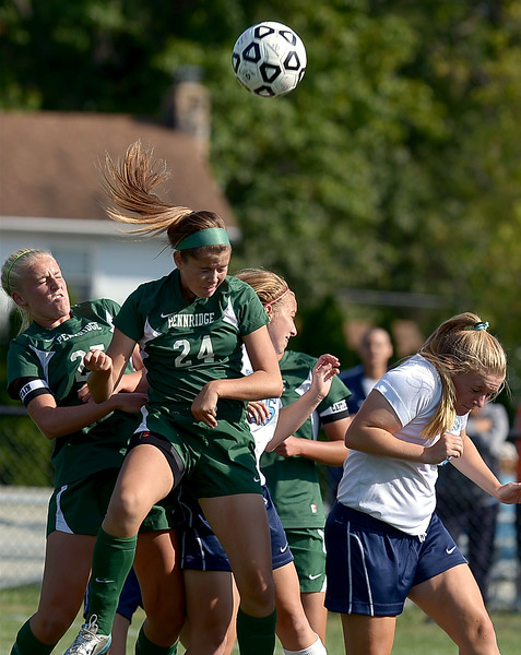Pennridge's Rachel Velez wins the battle for a head ball during Monday's game at North Penn, Sept. 15, 2014.<br /> Montgomery Media staff photo by Bob Raines