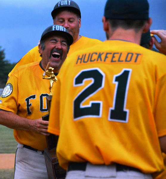 Gary Bonitatibus holds the Lower Montco American Legion championship trophy tight after the Generals winning game July 14, 2014. Photo by Debby High