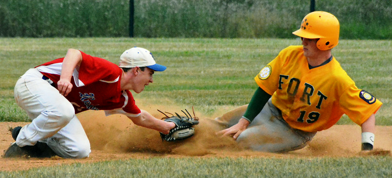 Generals Cole Swiger slide safe into 1st as the Hawks 1st basemen Matt McDonough attempted an out. Photo by Debby High