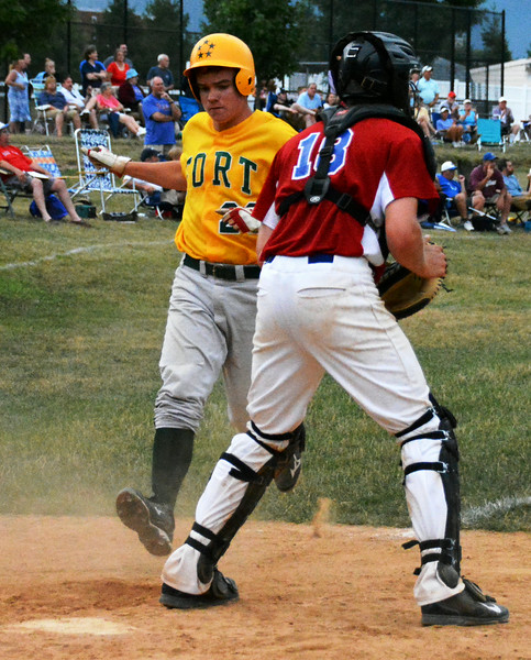 Generals, James Tralie hit homeplate during the final inning of the championship game. Photo by Debby High