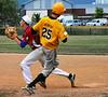 Generals Dan Jacobson, pitcher made it safe to 1st as matt McDonough covered the base. Photo by Debby High