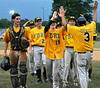 Ft. Washington Generals high-5 their coach as they walk off the field knowing they won the Lower Montco American Legion 2014 Championship. Photo by Debby High