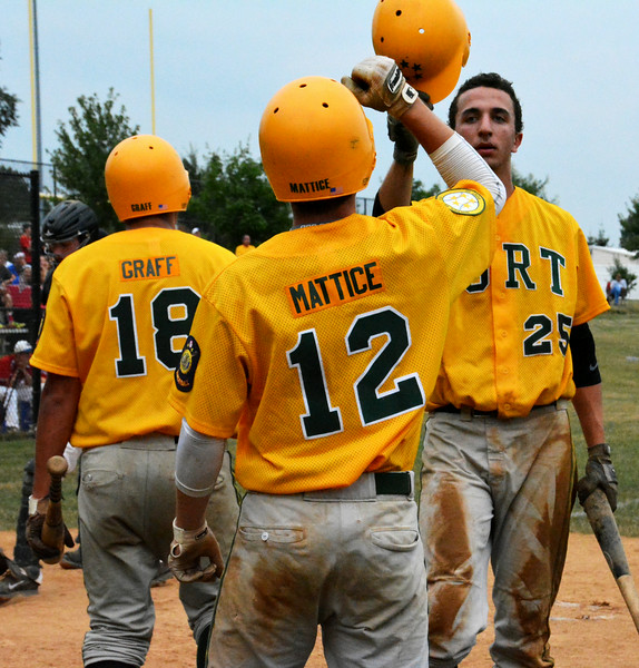 Generals Dan Jacobson, pitcher team gave congrats right after he ran over home plate. Photo by Debby High