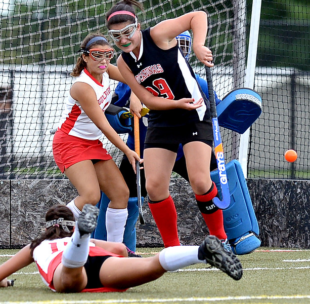 Souderton's Ali Casciato manages to get off a shot into the left side of the UD goal cage as she falls. Upper Dublin's Isabella Buce screens the play from the goal keeper Georgia Miller while trying to deflect the shot.<br /> Montgomery Media staff photo by Bob Raines