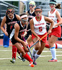 Upper Dublin's Maddie Templeton tries to clear the ball pursued by Souderton's Nina Disco.<br /> Montgomery Media staff photo by Bob Raines