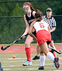 Upper Dublin's Courtney Vincent tries to move the ball upfield past Souderton's Nina Disco.<br /> Montgomery Media staff photo by Bob Raines