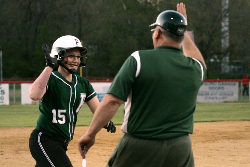 Pennridge's Morgan Labs high-fives the third base coach on her way to the plate after smacking a home run over the left field fence.