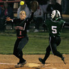 Hatboro Horsham's Heather Lutz gets the ball just in time to force out Pennridge's Haley Taylor at first base.