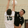 Upper Dublin's #27 gets his spike blocked back in his face by Pennridge's Bradley Nase.
