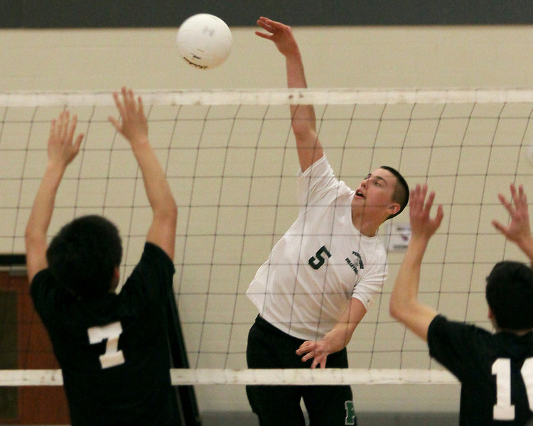 Pennridge's Kolby Smith spikes the ball across Upper Dublin's front line.