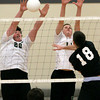 Pennridge's Vince Kauders and Devon Rice block an Upper Dublin spike.
