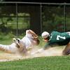 Pennridge shortstop Brak Misialek tags out LaSalle runner Joe Picard caught in a rundown at third base.