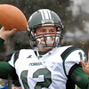 Quarterback Kyle Peters loosens up along sideline for annual Thanksgiving Day game against Quakertown, Thursday. KenZepp 11-25-10