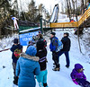 KRISTOPHER RADDER - BRATTLEBORO REFORMER<br /> People gather at the end of the inrun as Aiden Cudhea lifts into the air during the Pepsi Challenge / US Cup at the Harris Hill Ski Jump in Brattleboro, Vt., on Saturday, Feb. 18, 2017. Cudhea came in 10th in the junior division with a final score of 157.0.