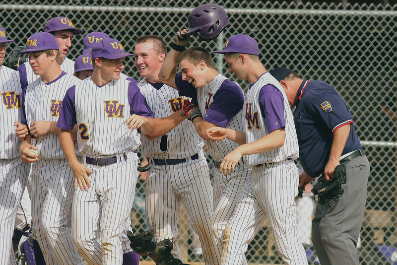 Upper Moreland's Tm Santry welcomed home after he clubs a solo home run against Phoenixville, following the one by previous batter Dave McInerney.<br /> Bob Raines 5/24/10