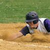 Upper Moreland's Pat McKay dives back to first.<br /> Bob Raines 5/24/10