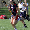 Plymouth Whitemarsh' Morgan Nagy carries the ball into Springfield territory.