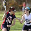 Plymouth Whitemarsh's Maddie Berman circles behind the crease looking to get by Springfield's Ione Gallagher.