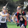 Plymouth Whitemarsh's Kirsten Monte drives for the crease past Springfield's Katie Morris.