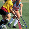 Meg Messmer, left, and Galen Newsome battle for the ball during field hockey practice at Plymouth Whitemarsh.<br /> Bob Raines 8/30/10