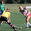 Galen Newsome, right, drives the ball past defenderHannah Heritage during field hockey practice at Plymouth Whitemarsh.<br /> Bob Raines 8/30/10