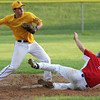Horsham's Adam Arcadia makes the throw to first after forcing Roslyn runner Mike Petriccione.