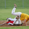 Horsham second baseman Adam Arcadia tumbles as Roslyn runner Justin Stokes slides into his ankles. Arcadia was charged with interference for blocking the bag, leaving stokes safe.