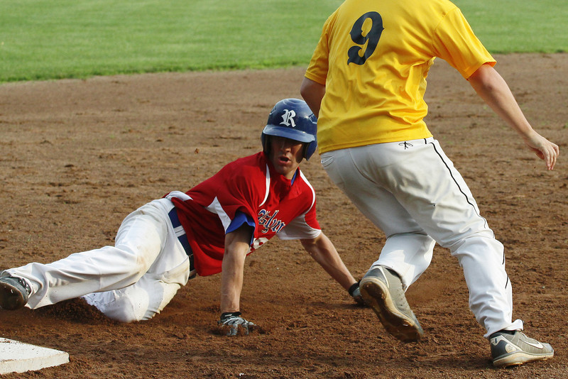 Roslyn's Sean Gallagher slides safely into third base.