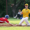 Roslyn runner Mike Petriccione beats the throw to Horsham first baseman Joe Simmons.
