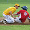 Horsham's Adam Arcadia puts the tag on Roslyn's Brendan Gallagher.