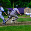 KRISTOPHER RADDER - BRATTLEBORO REFORMER<br /> Colchester's Justin Dattilio fails to stop the ball allowing Brattleboro to score two runs during a Division 1 Semifinal Playoff game at Brattleboro Union High School on Tuesday, June 5, 2018.