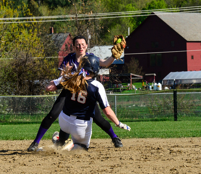 KRISTOPHER RADDER - BRATTLEBORO REFORMER<br /> Mount Anthony Union's Jamie Boyle slides into second before Brattleboro's Rachel Rooney during a softball game at Brattleboro Union High School on Wednesday, May 9, 2018.