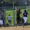 KRISTOPHER RADDER - BRATTLEBORO REFORMER<br /> Brattleboro's Jamie Mahoney reaches for a wild throw while Mount Anthony Union's Danielle Moscarello reaches home plate during a softball game at Brattleboro Union High School on Wednesday, May 9, 2018.