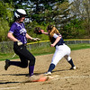 KRISTOPHER RADDER - BRATTLEBORO REFORMER<br /> Mount Anthony Union's stretches to get Brattleboro's Jamie Mahoney out at first during a softball game at Brattleboro Union High School on Wednesday, May 9, 2018.