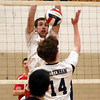 Souderton's Tim Jones goes up to block a shot by Cheltenham's Tom Corrigan..