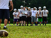 Chad Pacheco, head coach for the Brattleboro football team, talks to his players about how he wants them in position during special team plays.  Kristopher Radder / Reformer Staff