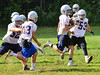 Players try to run through the defense while running kick-return plays.  Kristopher Radder / Reformer Staff