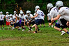 Members of the Brattleboro football team practice plays they will run during kick-off.  Kristopher Radder / Reformer Staff