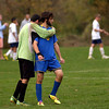 Delco goal keeper Dave Sousa embraces Nick Gurenlian after losing to Wissahickon.