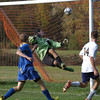 Springfield Delco goal keeper Dave Sousa can't stop a head ball by Wissahickon's Pat Magdalinski, right.