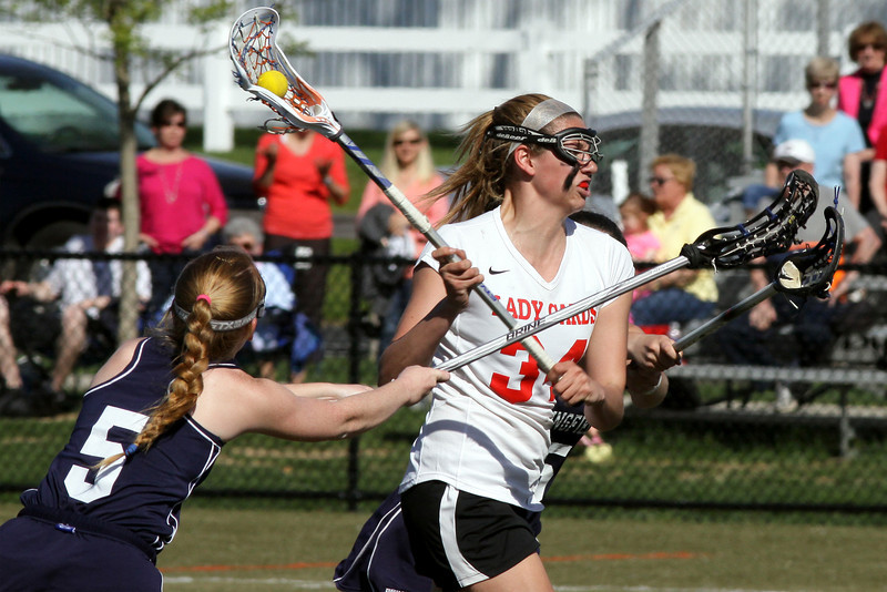 Upper Dublin's Julie Cross drives to the crease for a score.