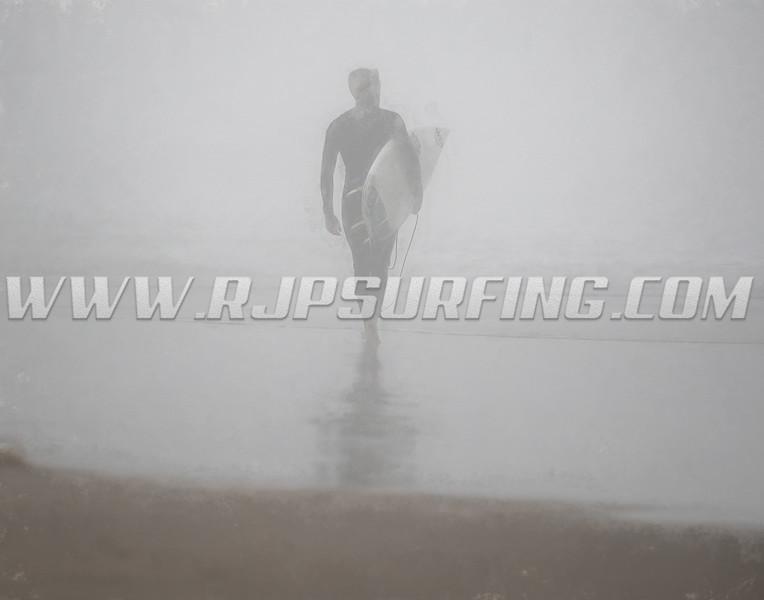 Surfer Walking into the Fog