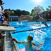 KRISTOPHER RADDER - BRATTLEBORO REFORMER<br /> Brattleboro's Jordy Allembert  leaps off the starting block in the Boys 12 & Under 200 Yard Medley Relay during a swim meet at the Brattleboro Living Memorial Park Pool on Tuesday, July 11, 2017.