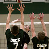 William Tennent's Brian Ebert gets set to spike the ball over Christopher Dock's Jared Hunsinger and Colton Young.