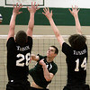 Christopher Dock's Logan Hunsberger spikes the ball past William Tennent's Tom Del Conte, left and Josh Ferguson.