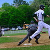 KRISTOPHER RADDER - BRATTLEBORO REFORMER<br /> Leland & Gray's first baseman Grayson VanHendrick could not get the ball to get the double play during a baseball game at Leland & Gray Union Middle and High School on Wednesday, May 23, 2018.