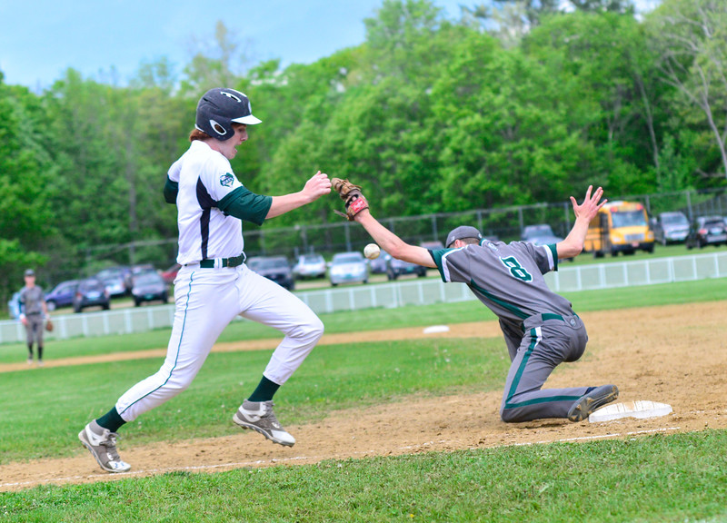 KRISTOPHER RADDER - BRATTLEBORO REFORMER<br /> Leland & Gray's first baseman Grayson VanHendrick could not get the ball on a wild throw as Woodstock's Andy Seiple makes it to first during a baseball game at Leland & Gray Union Middle and High School on Wednesday, May 23, 2018.